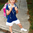 Schoolgirl is on the way to school for the first time — Stock Photo #47747281