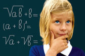 Schoolgirl ponders solving a mathematical problem  — Stock Photo