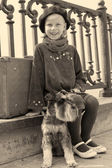 Vintage old photo of a little girl and his dog — Stock Photo