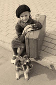 Vintage photo of a little girl and his dog — Stock Photo