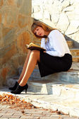 Student sitting on the steps — Stock Photo