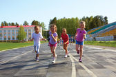Group of children running on the treadmill — Stock Photo