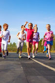 Happy little girl finish first — Stock Photo