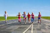 Group of children running on the treadmill — Stock Photo