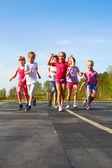 Happy little girl finish first — Foto de Stock