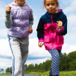 Two girls in sportswear standing at the start — Stock Photo #50401601