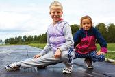 Children training on stadium stretching — Stock Photo