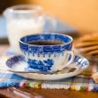Blue coffee cup with cookies — Stock Photo
