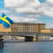 Swedish flag with the Royal Castle — Stock Photo