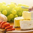 Brie cheese with olives and chorizo — Stok fotoğraf