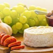 Brie cheese with olives and chorizo - Stock Photo