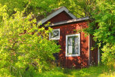 Red wooden summerhouse — Stock Photo