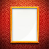 Picture frame on red wallpaper — Stock Photo