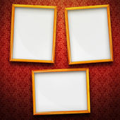 Three big picture frames on vintage background — Stock Photo