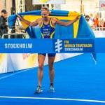 Постер, плакат: Stockholm Lisa Norden thru the finish line happy with the Swe