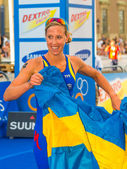Stockholm - Lisa Norden happy with the Swedish flag in her hand — Stock Photo