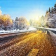 Foto Stock: Winter road in sunlight