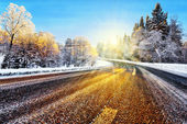 Winter road in sunlight — Stock Photo