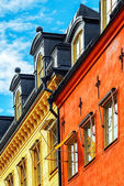 Red and yellow facade of buildings with windows — Stock Photo