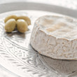 Stock Photo: Camembert on tray with olives