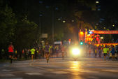 STOCKHOLM - AUG, 17: Minutes before the start for the first group of the Midnight Run (Midnattsloppet) event, people jogging to the startingline. Aug 17, 2013 in Stockholm, Sweden — Stockfoto