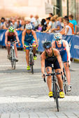 STOCKHOLM - AUG, 24: A group of female cyclist with Pamela Oliveira and Lotte Miller in from after the transition from the swimming in the Womens ITU World Triathlon Series event — Stock Photo