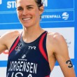 Постер, плакат: STOCKHOLM AUG 24: Gold medalist Gwen Jorgensen before the nat