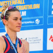 STOCKHOLM - AUG, 24: Gold medalist Gwen Jorgensen during the national anthem at the Womens ITU World Triathlon Series event Aug 24, 2013 in Stockholm, Sweden — Stock Photo