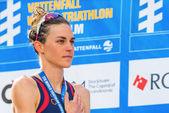 STOCKHOLM - AUG, 24: Gold medalist Gwen Jorgensen during the national anthem at the Womens ITU World Triathlon Series event Aug 24, 2013 in Stockholm, Sweden — Stock Photo
