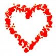 Stock Photo: Heart made with red stearine on white