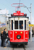 Red classic tram with passengers entering at the Taksim — Stock Photo