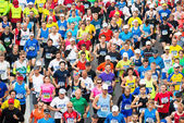 Group of runners after the start of ASICS Stockholm Marathon — Stock Photo