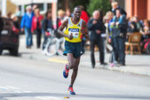 Patrick Korir from Kenya later came in as number seven in ASICS  — Stock Photo