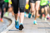 Woman legs and feet closup Marathon — Stock Photo