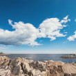 Baltic rocky coastline with a cloudy sky during summer — Stock Photo #48654987