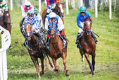 Jockeys into the second curve at the Nationaldags Galoppen — Stock Photo
