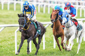 Three jockeys out of the fourth curve at the Nationaldags Galopp — Foto de Stock
