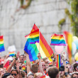 Happy crowd waving rainbow flags — Stock Photo #50737949