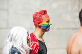 Man with a head in rainbow painting — Stock Photo