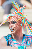 Man with a colorful straws as a hat during Stockholm Pride Parad — Stock Photo