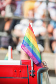 Small rainbow flag ontop of a bus during Stockholm Pride Parade — Stock Photo