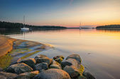 Tranquil scene with sailboats moored for the night — Stock Photo