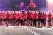 After start of one of many groups in the Midnight Run — Stock Photo