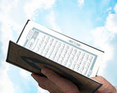 Hand with Pocket Quran — Stock Photo