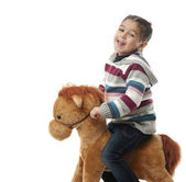 Happy Girl on Rocking Horse — Stock Photo