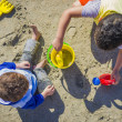 Stock Photo: Two Boys with Beach Toys