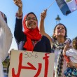 Egyptian Girl Protesting with LEAVE Sign — Stock Photo #27570307