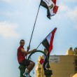 Man with Egyptian Flags — Stock Photo