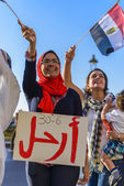 Egyptian Girl Protesting with LEAVE Sign — Stock Photo