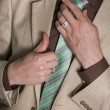 Man Fixing His Tie — Stock Photo #31100141